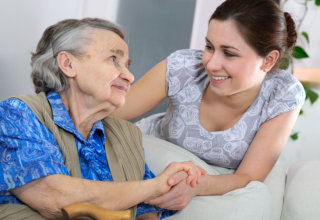caregiver and old woman showing their affection to each other